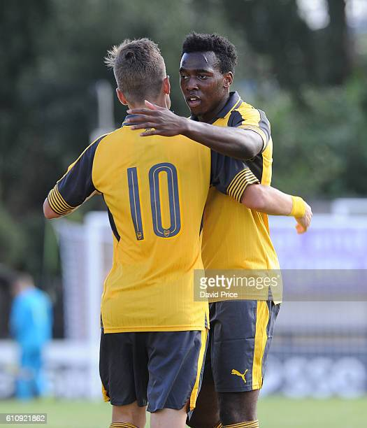 Vlad Dragomir celebrates scoring a goal for Arsenal with Tolaji Bola during the UEFA Champions League match between Arsenal FC and FC Basel 1893 at...
