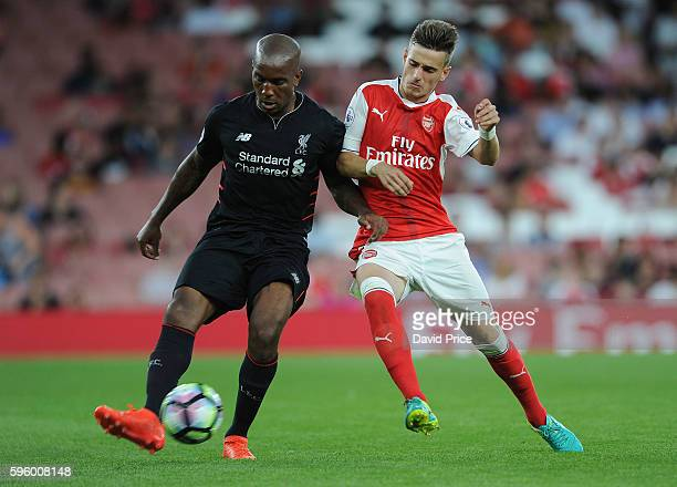 Vlad Dragomir of Arsenal closes down Andre Wisdom of Liverpool during the match between Arsenal U23 and Liverpool U23 at Emirates Stadium on August...
