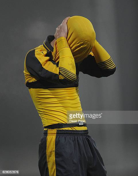 Vlad Dragomir of Arsenal dejected after the match the UEFA Champions League match between FC Basel and Arsenal at Leichtathletik Stadion on December...
