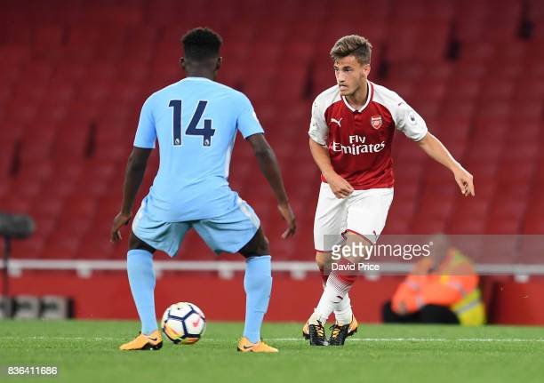 Vlad Dragomir of Arsenal passes the ball under pressure from Tomiwa DeleBashiru of Manchester City during the match between Arsenal U23 and...