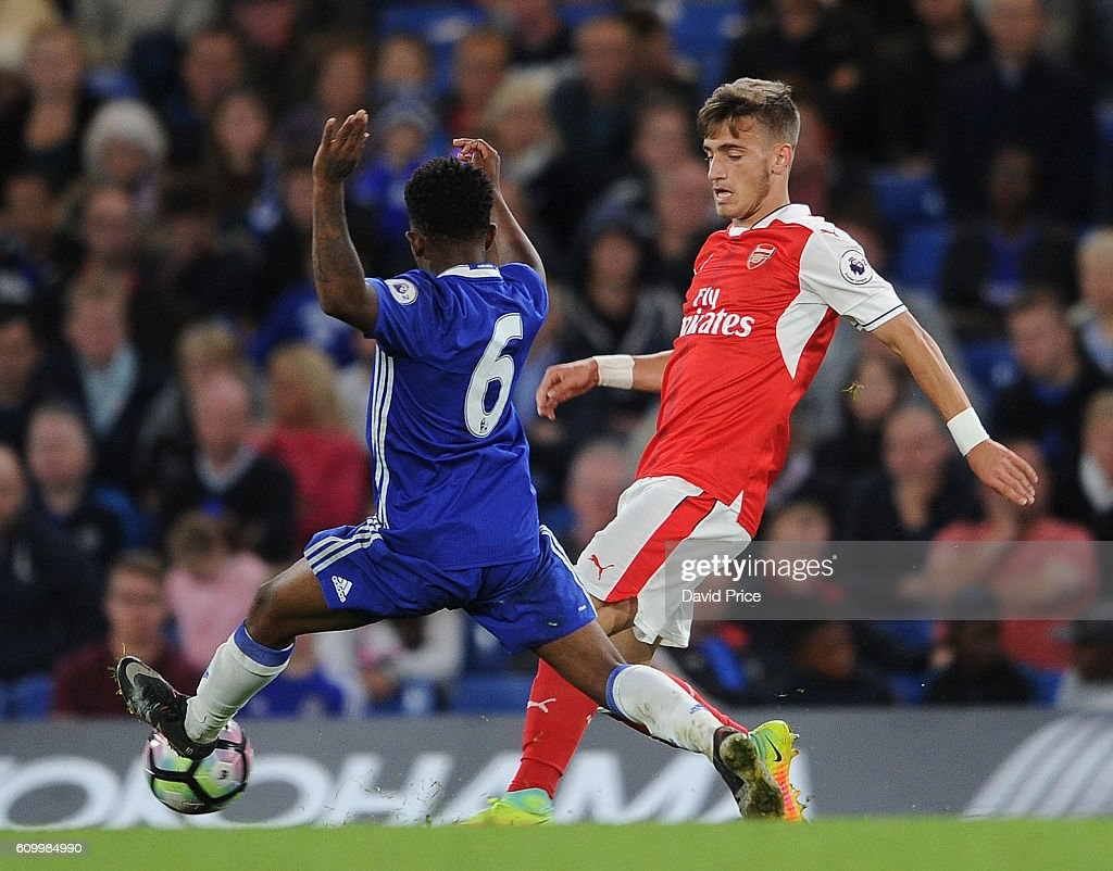 Vlad Dragomir of Arsenal passes under pressure from Josimar Quintero of Chelsea during the match between Chelsea U23 and Arsenal U23 at Stamford Bridge on September 23, 2016 in London, England.
