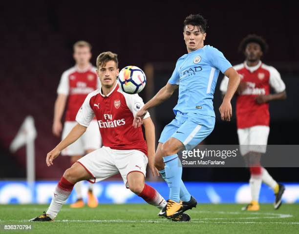 Vlad Dragomir of Arsenal takes on Brahim Diaz of Man City during the Premier League 2 match between Arsenal and Manchester City at Emirates Stadium...