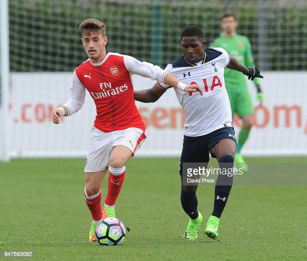 Vlad Dragomir of Arsenal takes on Shilow Tracey of Tottenham during the match between Arsenal U23 and Tottenham Hotspur U23 at London Colney on March...