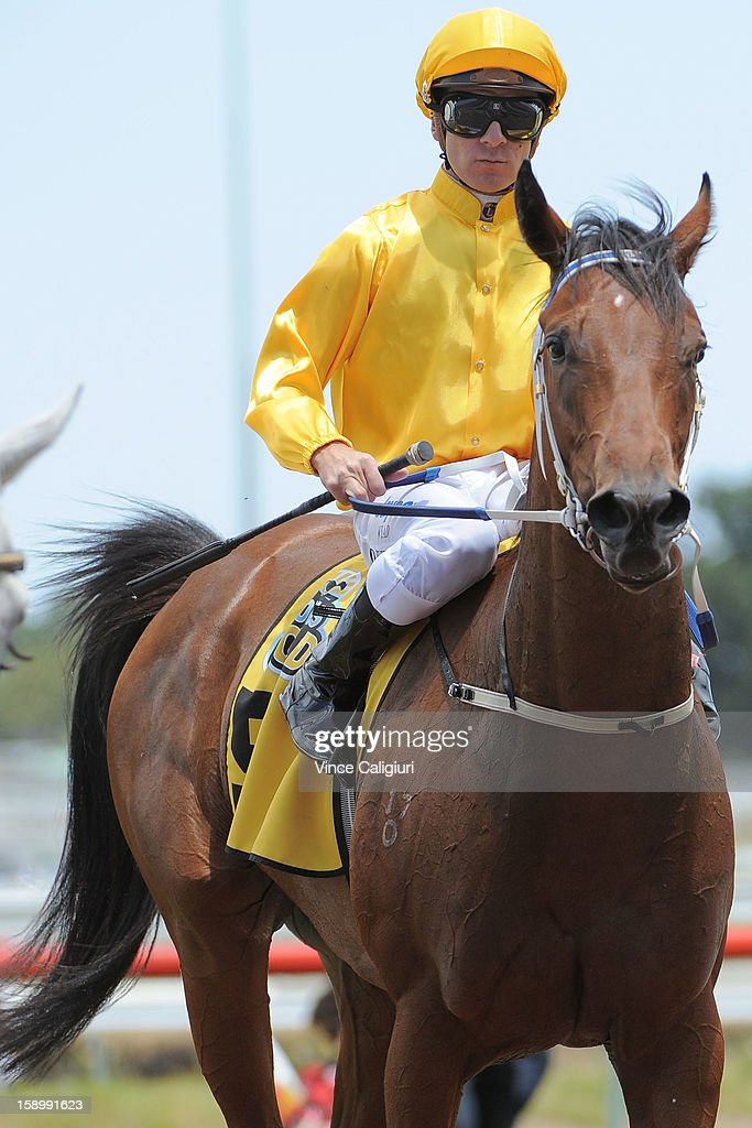 Vlad Duric riding Diamond Glow after winning the Ian Miller Vobis Gold Carat during Caulfield racing at Caulfield Racecourse on January 5, 2013 in Melbourne, Australia.