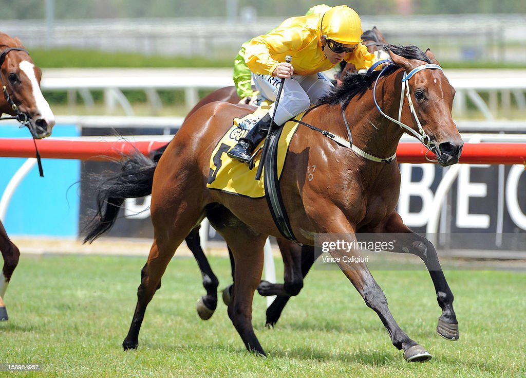Vlad Duric riding Diamond Glow wins the Ian Miller Vobis Gold Carat during Caulfield racing at Caulfield Racecourse on January 5, 2013 in Melbourne, Australia.