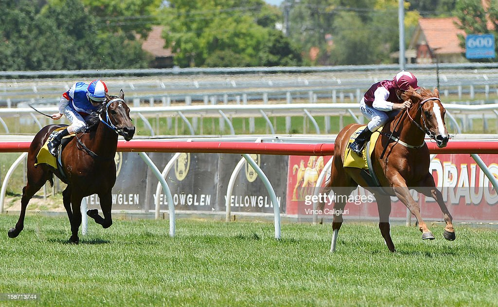Vlad Duric riding Montsegur defeats Luke Nolan riding Calcatta during the Joe Brown Plate at Caulfield Racecourse on December 26, 2012 in Melbourne, Australia.