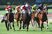 Vlad Duric riding Mourinho defeats Matthew Allen riding It is Written and Ben Melham riding Dissident in Race 7 the Jeep Australia Stakes during...