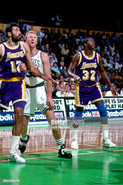 Vlade Divac and Magic Johnson battle for position against Larry Bird of the Boston Celtics during a game played in 1992 at the Boston Garden in...