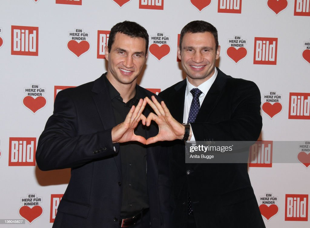 Vladimir (L) and <a gi-track='captionPersonalityLinkClicked' href=/galleries/search?phrase=Vitali+Klitschko&family=editorial&specificpeople=206402 ng-click='$event.stopPropagation()'>Vitali Klitschko</a> arrive for the 'Ein Herz fuer Kinder' Charity Gala on December 17, 2011 in Berlin, Germany.