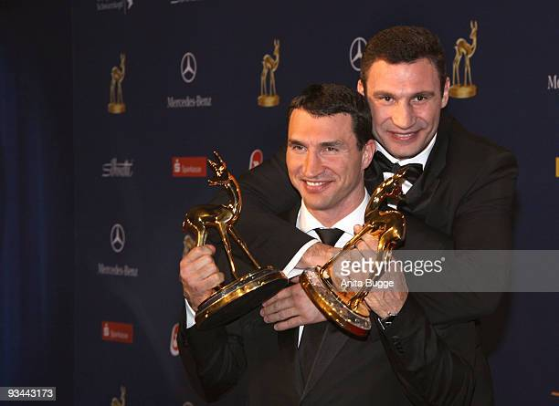 Vladimir and Vitali Klitschko pose with their award for sport at the Bambi Awards 2009 at the Metropolis Hall at the Filmpark Babelsberg on November...