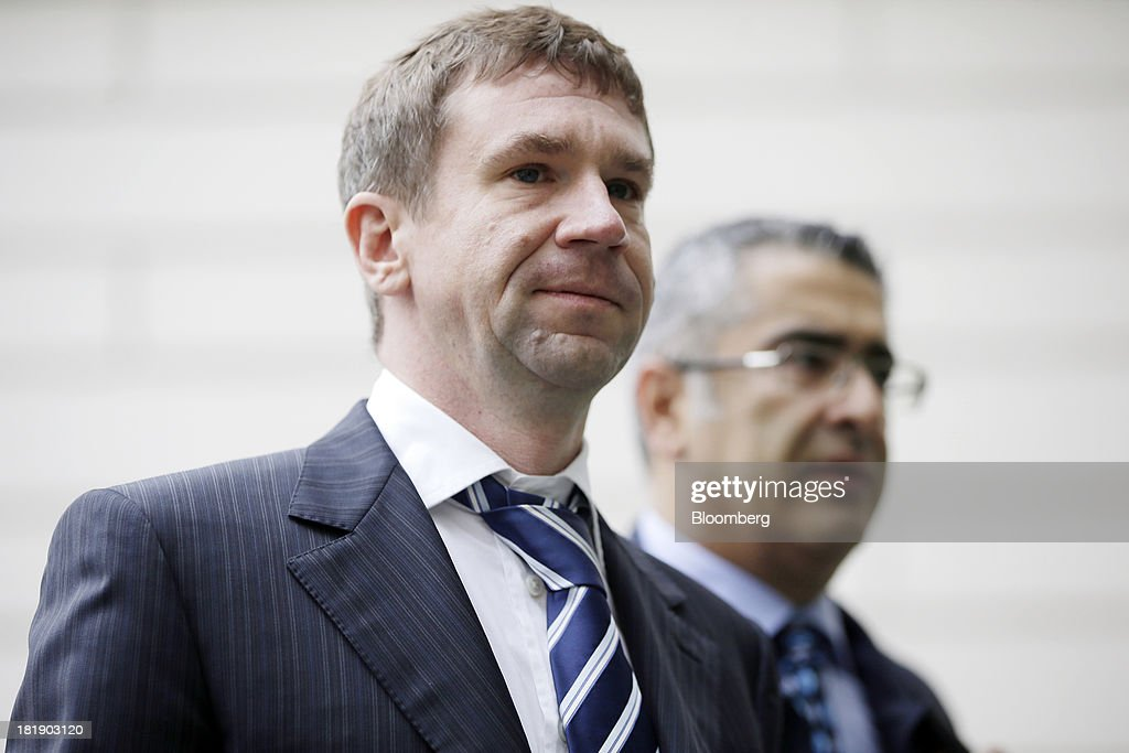 Vladimir Antonov, former co-owner of Bankas Snoras AB, and co-owner of Convers Sports Initiatives Plc (CSI), owners of Portsmouth Football Club, left, arrives at Westminster Magistrates Court in London, U.K., on Thursday, Sept. 26, 2013. Antonov, a Russian, who is fighting extradition to Lithuania to face possible fraud charges, and his Lithuanian business partner Raimondas Baranauskas were detained in London in 2011 after Lithuania issued a European arrest warrant on claims the men siphoned at least 1.7 billion litas ($668 million) from the country's third-biggest bank by deposits, causing its collapse. Photographer: Matthew Lloyd/Bloomberg via Getty Images