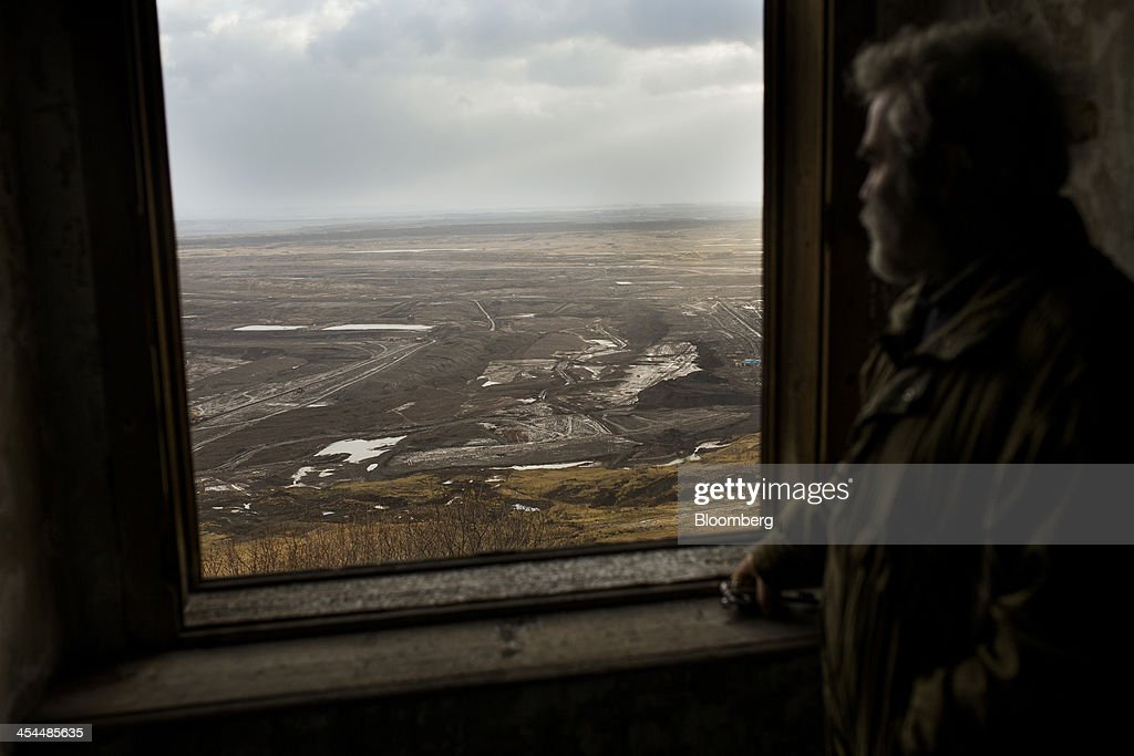 Vladimir Burt, deputy mayor of Horni Jiretin, looks out from Jerezi Chateau over the open pit mining site for lignite operated by Czech Coal AS near Horni Jiretin, Czech Republic, on Friday, Dec. 6, 2013. The government may set up a joint company with Severni Energeticka that will seek lifting current environmental limits on lignite mining, Lidove Noviny reports, citing proposal submitted by Industry and Trade Ministry. Photographer: Bartek Sadowski/Bloomberg via Getty Images
