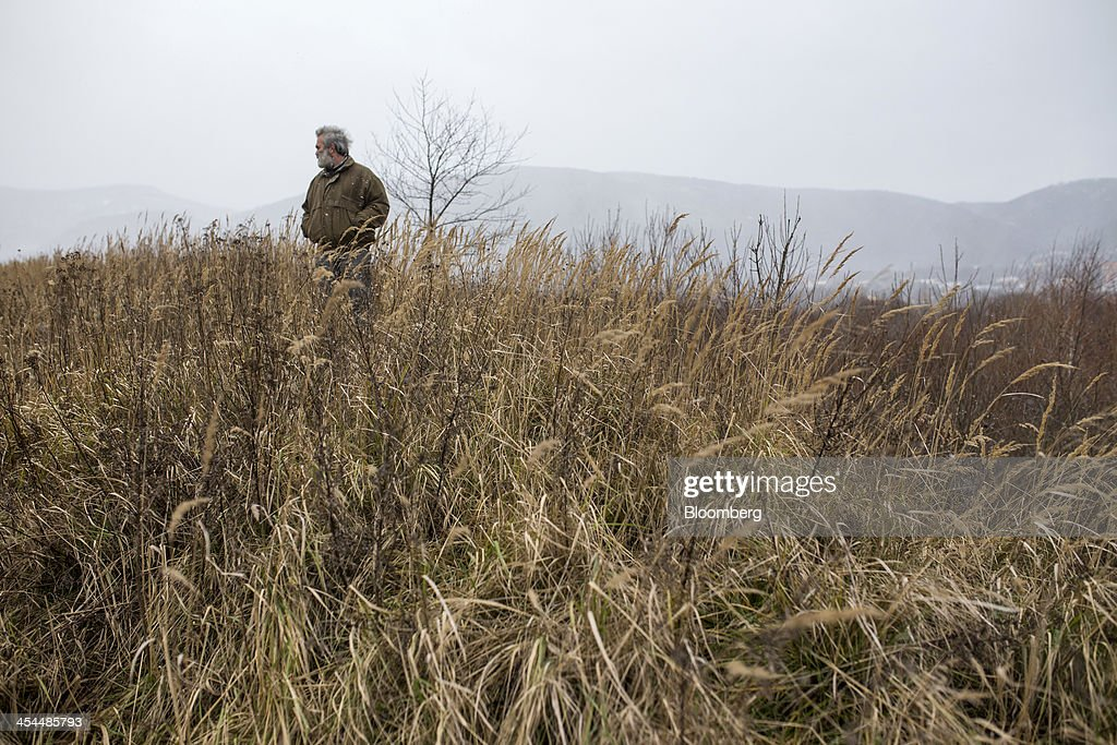Vladimir Burt, deputy mayor of Horni Jiretin, walks on an area of reclaimed land at a lignite mining site near Horni Jiretin, Czech Republic, on Friday, Dec. 6, 2013. The government may set up a joint company with Severni Energeticka that will seek lifting current environmental limits on lignite mining, Lidove Noviny reports, citing proposal submitted by Industry and Trade Ministry. Photographer: Bartek Sadowski/Bloomberg via Getty Images