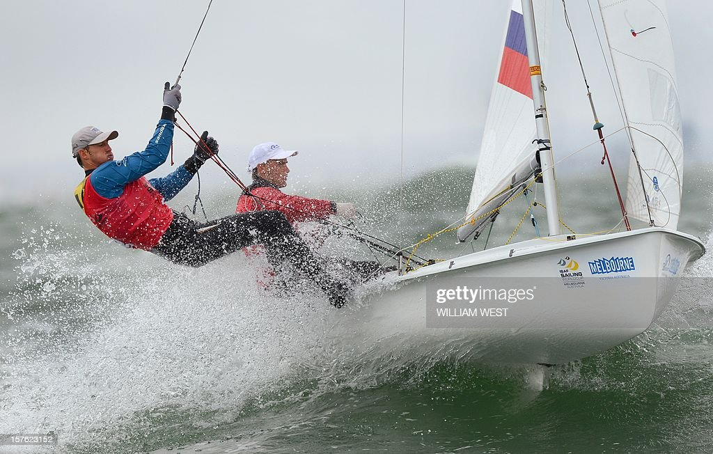 Vladimir Chaus and Denis Gribanov of Russia sail through the waves in the 470 Men's class at the ISAF Sailing World Cup event in Melbourne on December 5, 2012. AFP PHOTO/William WEST IMAGE RESTRICTED TO EDITORIAL USE - STRICTLY NO COMMERCIAL USE