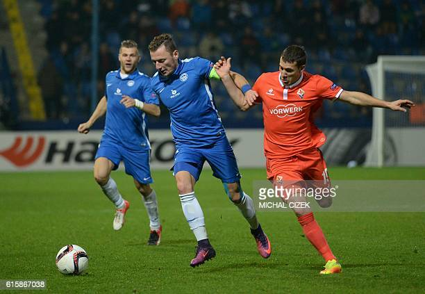 Vladimir Coufal of FC Slovan Liberec vies for a ball with Sebastian Cristoforo of ACF Fiorentina during Europa League football match FC Slovan...