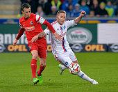 Vladimir Dariada of Freiburg challenges Lewis Holtby of Hamuburger SV during the Bundesliga match between SC Freiburg and Hamburger SV at...