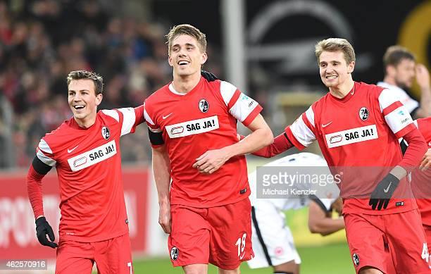 Vladimir Darida Nils Petersen and Immanuel Hoehn of Freiburg celebrate the second goal of Petersen during the Bundesliga match between SC Freiburg...