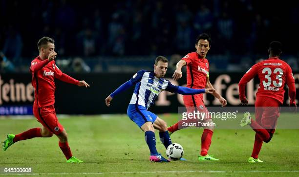 Vladimir Darida of Berlin and Makoto Hasebe of Frankfurt battle for the ball during the Bundesliga match between Hertha BSC and Eintracht Frankfurt...