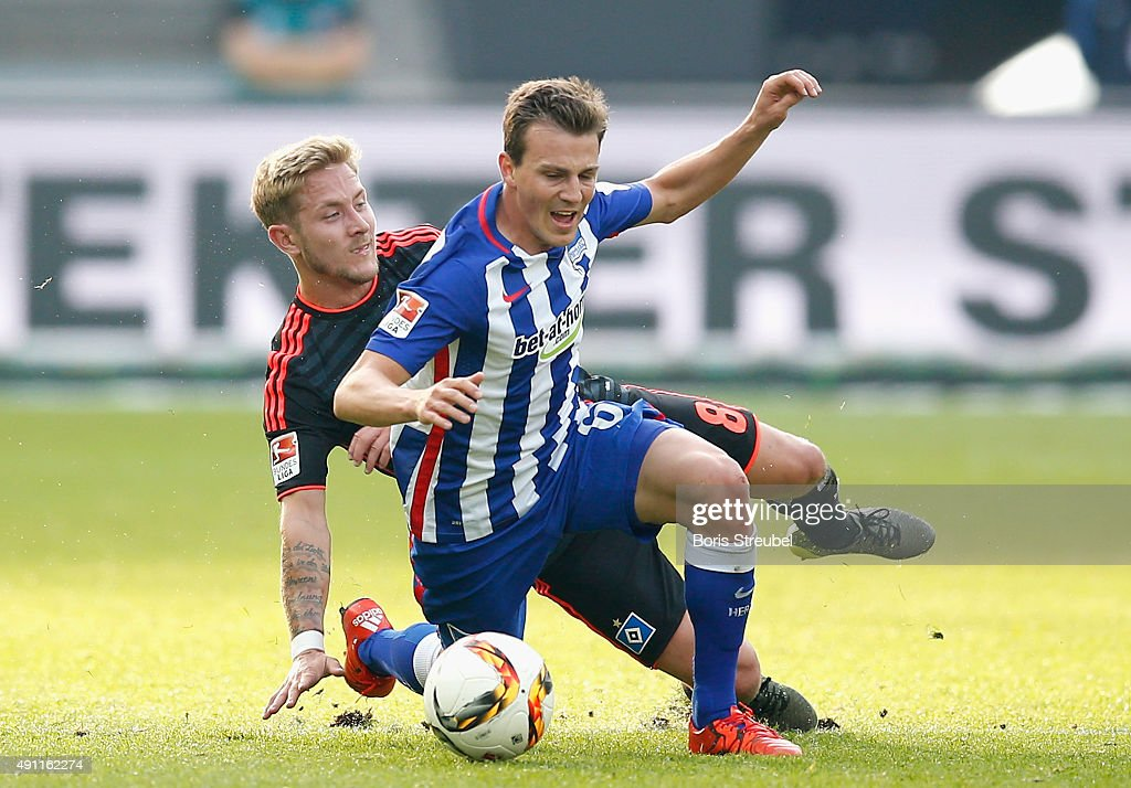 Vladimir Darida (R) of Berlin is challenged by Lewis Holtby of Hamburger SV during the Bundesliga match between Hertha BSC and Hamburger SV at Olympiastadion on October 3, 2015 in Berlin, Germany.