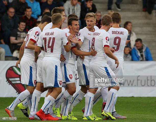 Vladimir Darida of Czech Republic celebrates with teammates after he scored during the Euro 2016 qualifying football match between Latvia and Czech...