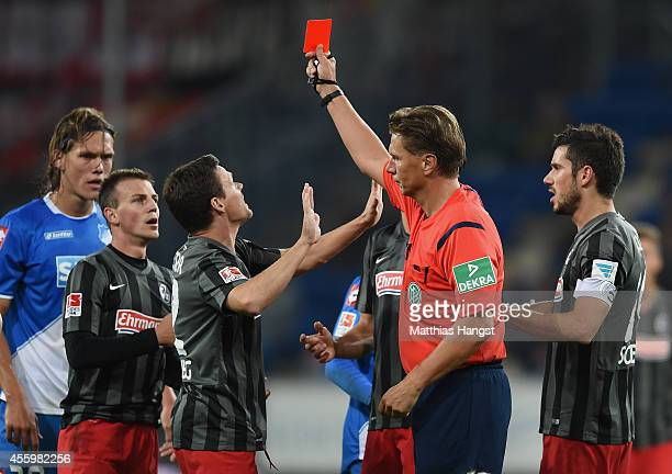 Vladimir Darida of Freiburg is shown a red card by referee Thorsten Kinhoefer during the Bundesliga match between TSG 1899 Hoffenheim and SC Freiburg...