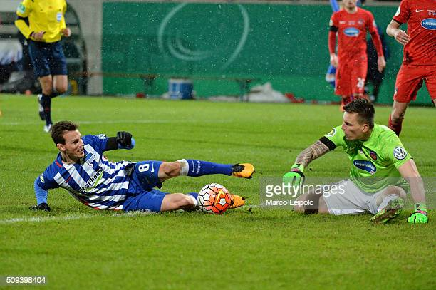 Vladimir Darida of Hertha BSC and Kevin Mueller of 1 FC Heidenheim during the cup match between 1 FC Heidenheim and Hertha BSC on february 10 2016 in...