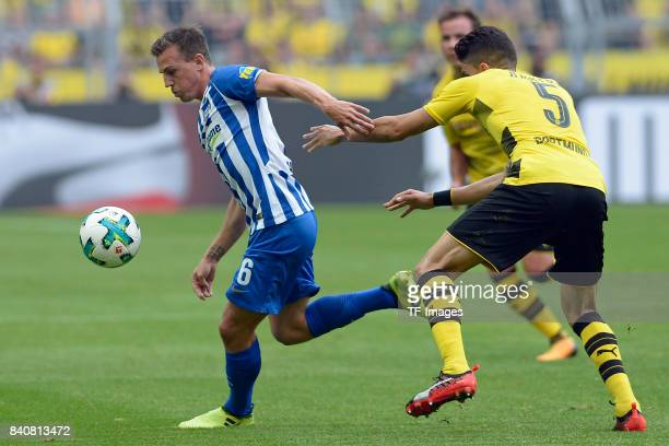 Vladimir Darida of Hertha BSC Berlin and Marc Bartra of Dortmund battle for the ball during the Bundesliga match between Borussia Dortmund and Hertha...