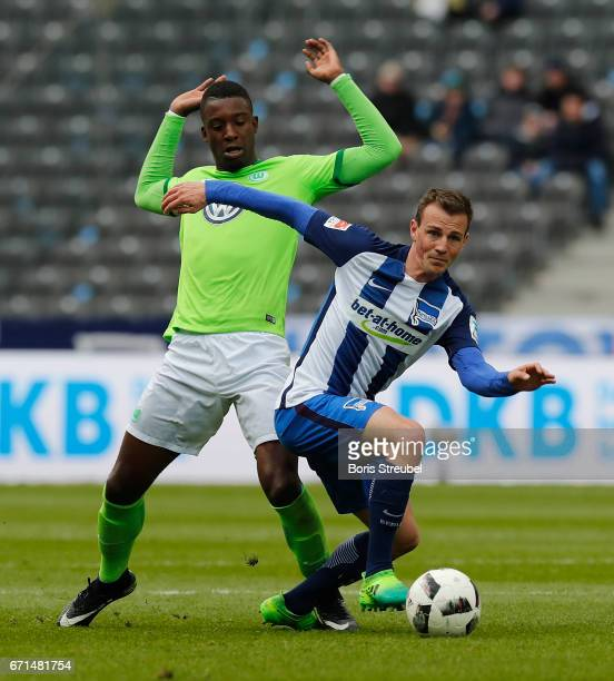 Vladimir Darida of Hertha BSC is challenged by Riechedly Bazoer of VfL Wolfsburg during the Bundesliga match between Hertha BSC and VfL Wolfsburg at...