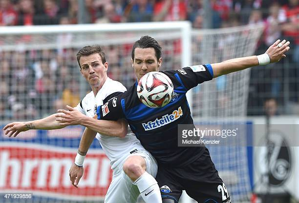 Vladimir Darida of SC Freiburg challenges Srdjan Lakic of SC Paderborn 07 during the Bundesliga match between Sport Club Freiburg and SC Paderborn 07...