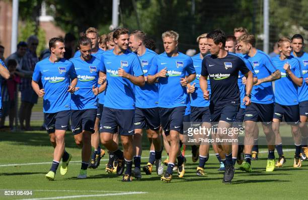 Vladimir Darida Valentin Stocker Niklas Stark Per Skjelbred and Fitnesstrainer Henrik Kuchno of Hertha BSC run sich warm during the training on...