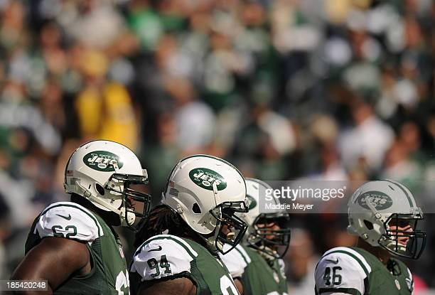 Vladimir Ducasse Damon Harrison and Tanner Purdum of the New York Jets look on during the first half against the New England Patriots at MetLife...