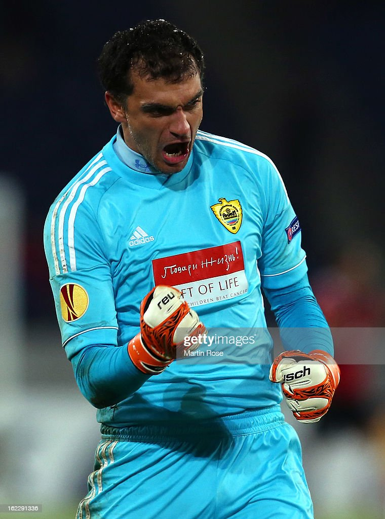 Vladimir Gabulov goalkeeper of Makhachkala celebrates after the UEFA Europa League Round of 32 second leg match between Hannover 96 and Anji...