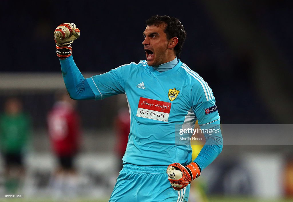 <a gi-track='captionPersonalityLinkClicked' href=/galleries/search?phrase=Vladimir+Gabulov&family=editorial&specificpeople=2276160 ng-click='$event.stopPropagation()'>Vladimir Gabulov</a>, goalkeeper of Makhachkala celebrates after the UEFA Europa League Round of 32 second leg match between Hannover 96 and Anji Makhachkala at AWD Arena on February 21, 2013 in Hannover, Germany.