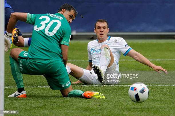 Vladimir Gabulov of FC Dynamo Moscow and Artem Dzyuba of FC Zenit St Petersburg look on the ball during the Russian Football Premier League match...