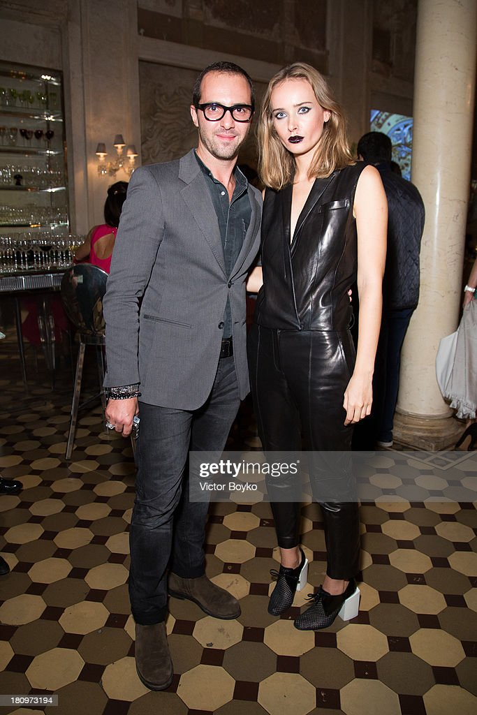 Vladimir Glynin and Olga Sorokina attends the dinner celebrating the opening of Vadim Zakharov's 'Dead Languages Dance' special project as part of the 5th Moscow Modern Art Biennale on September 18, 2013 in Moscow, Russia.