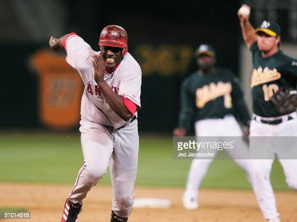 Vladimir Guerrero of the Anaheim Angels is caught in a rundown after overrunning first base on a single as Scott Hatteberg of the Oakland Athletics...
