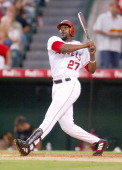 Vladimir Guerrero of the Los Angeles Angels of Anaheim hits a solo home run for his 15th homer in the sixth inning of a 75 loss to the Minnesota...