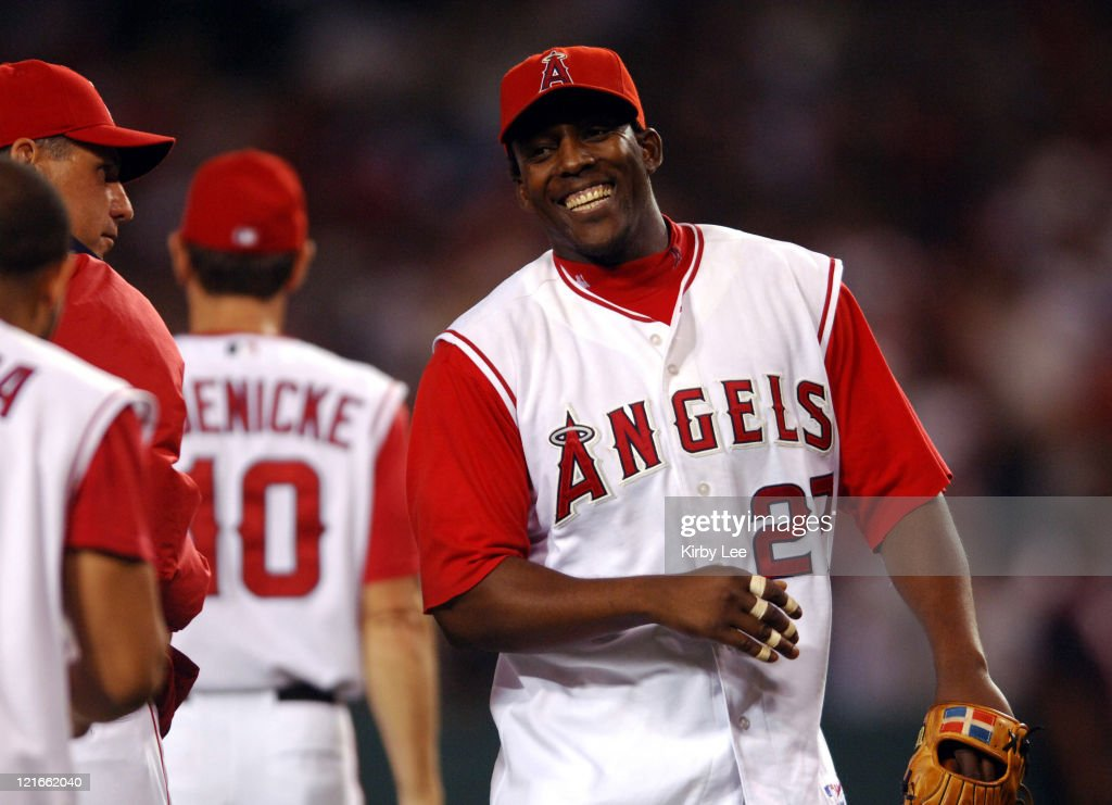 Vladimir Guerrero of the Los Angeles Angels of Anaheim smiles after a 8-6 victory over the New York Yankees at Angel Stadium in Anaheim, Calif. on Saturday, July 23, 2005.