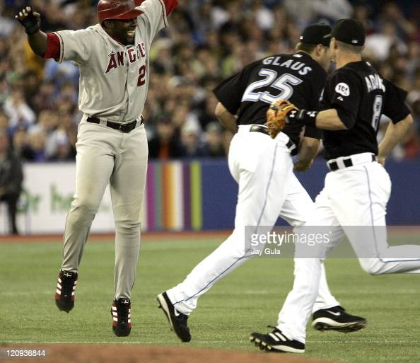 Vladimir Guerrero of the Los Angeles Angels of Anaheim was tagged out by Toronto Blue Jays 3B Troy Glaus after being caught in a rundown between 2nd...