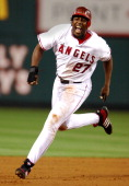 Vladimir Guerrero of the Los Angeles Angels sprints toward third base during Major League Baseball game against the Detroit Tigers at Angel Stadium...