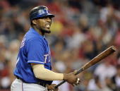 Vladimir Guerrero of the Texas Rangers reacts in his ninth inning at bat trailing by one run against the Los Angeles Angels at Angel Stadium on June...