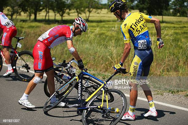Vladimir Gusev of Russia and Katusha and Pawel Poljanski of Poland and TinkoffSaxo untangle their bikes after they are involved in a crash during the...