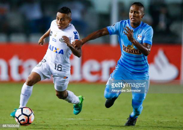 Vladimir Hernandez of Santos and Pedro Aquino of Sporting Cristal in action during the match between Santos and Sporting Cristal for the Copa...