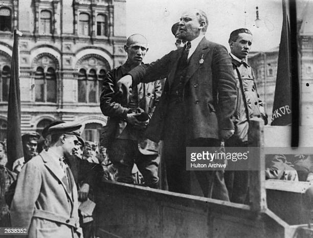 Vladimir Ilyich Lenin Russian dictator gives a speech from the back of a vehicle in a Russian street