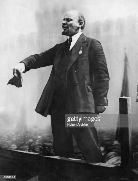 Vladimir Ilyich Lenin the Russian Dictator standing and addressing a crowd