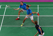 Vladimir Ivanov and Ivan Sozonov of Russia compete in the Men's Badminton Doubles final against Mathias Boe and Carsten Mogensen of Denmark on day...
