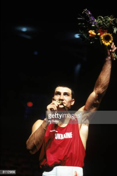 Vladimir Klitschko of the Ukraine celebrates his Gold Medal win against Paea Wolfgram of Tongo in the 91kg final during the XXVI Olympic Games at...