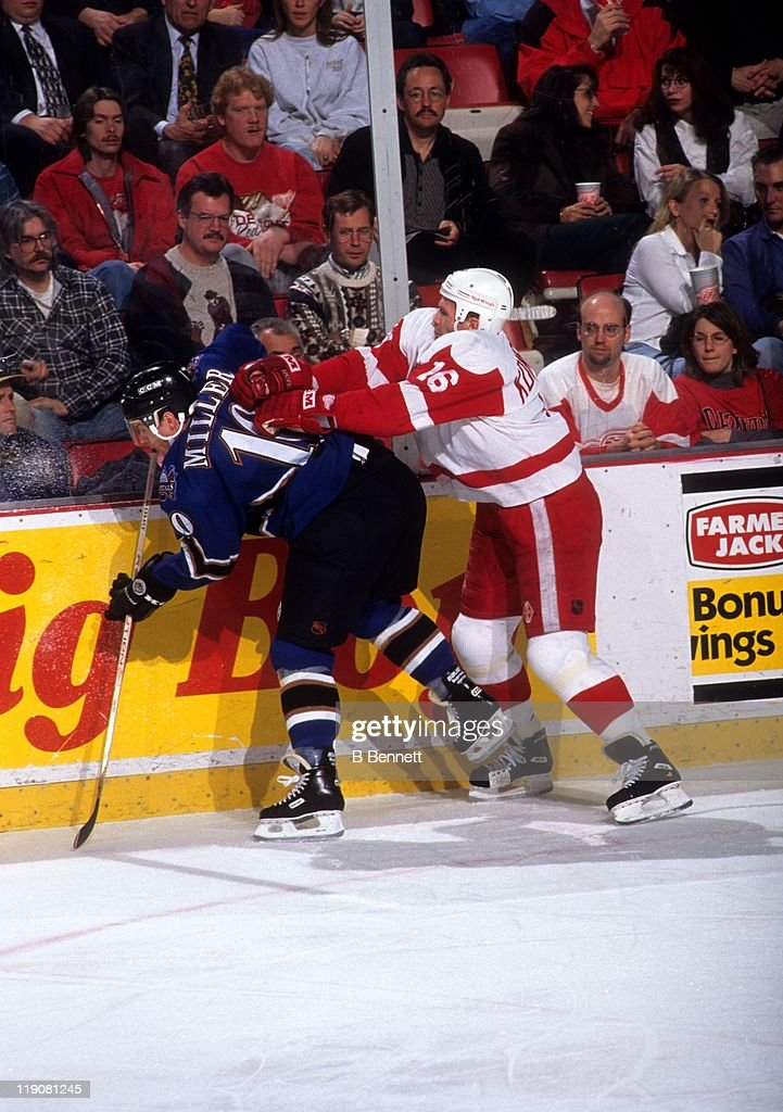 Vladimir Konstantinov #16 of the Detroit Red Wings checks Kelly Miller #10 of the Washington Capitals into the boards during their game on February 15, 1996 at the Joe Louis Arena in Detroit, Michingan.