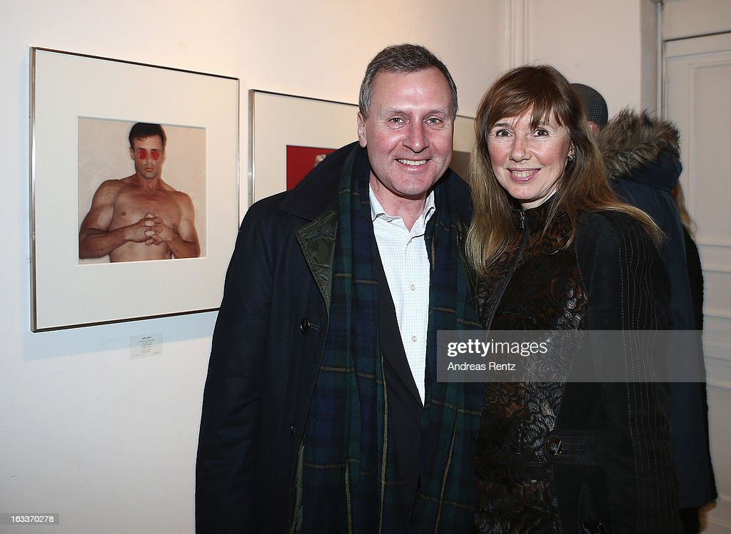 Vladimir Kotenev and wife Maria Koteneva attend the Michel Comte vernissage at Gallery Camera Work on March 8, 2013 in Berlin, Germany.