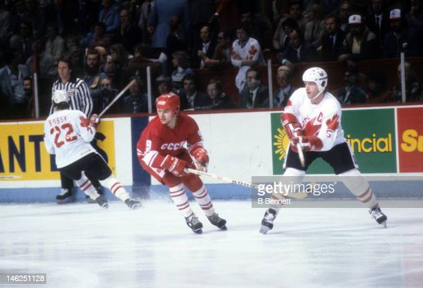 Vladimir Krutov of the Soviet Union defends against Denis Potvin of Canada during the 1984 Canada Cup on September 13 1984 at the Olympic Saddledome...